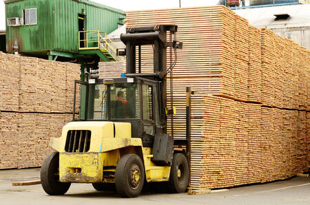 2x4: Large lift truck moving a stack of green fir 2 x 4 lumber studs at a small log processing mill in southern Oregon, ready for the drying kiln