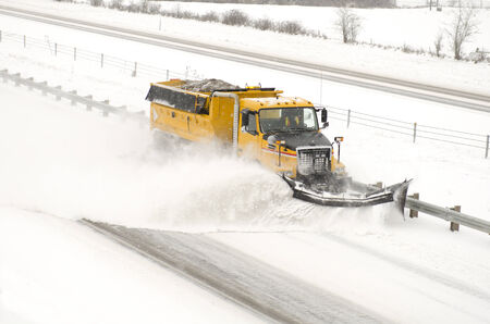 Snow plows clearing the freeway on Interstate 5 during a winter snow and freezing rain storm photo