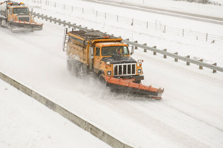 bad weather: Snow plows clearing the freeway on Interstate 5 during a winter snow and freezing rain storm
