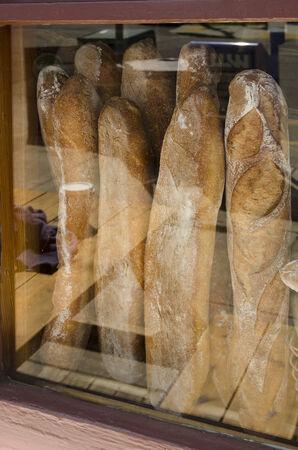 Stacks of fresh baked bread at an artisian bakery restaurant in Portland Oregon photo