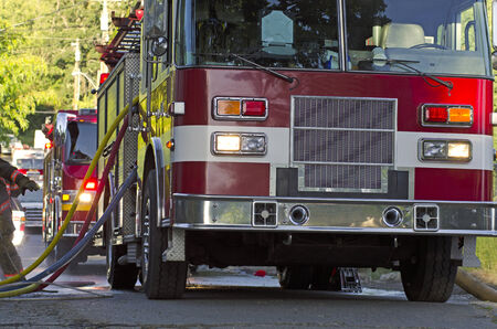 turnouts: Firefighters respond to a single family home fire on a hot summer day in Roseburg, OR, USA on June 10, 2014