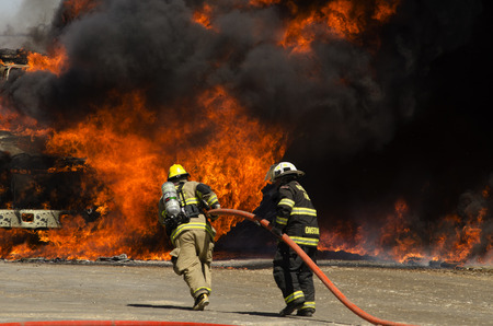 Fire fighters respond to a semi truck and silage fire at a dairy farm in Gustine, CA, on June 18, 2014 Редакционное