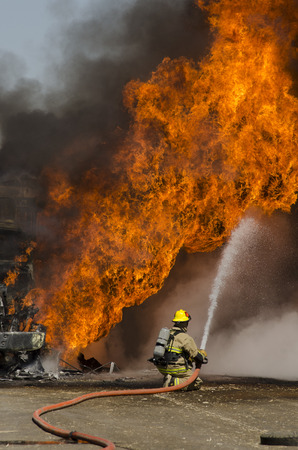 turnouts: Fire fighters respond to a semi truck and silage fire at a dairy farm in Gustine, CA, on June 18, 2014 Editorial