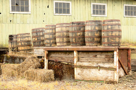 near beer: Wine barrels sittng on a loading dock at a large winery and beer brewery in the Willamette Valley near Portland Oregon Stock Photo