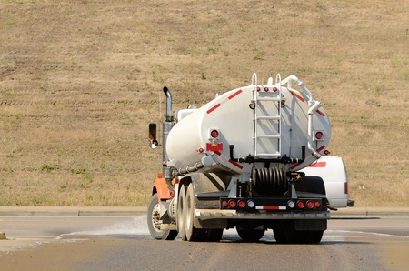 wetting: Large tank truck working at a construction site