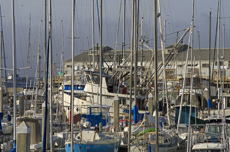 Fishing boats leaving port and marina to go fishing in the Pacfic Ocean in Monterey California