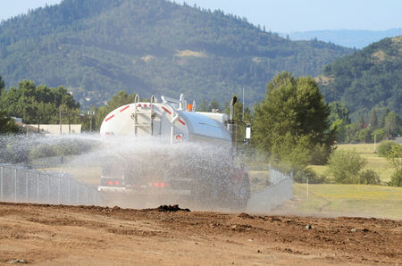 wetting: at a large construction site removing a hill during an airport runway expansion project