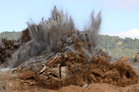 A sequence of images of a blasting operation of a rock hill to make way for an airport runway expansion project.