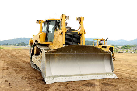 A large bulldozer at an construction site 스톡 콘텐츠