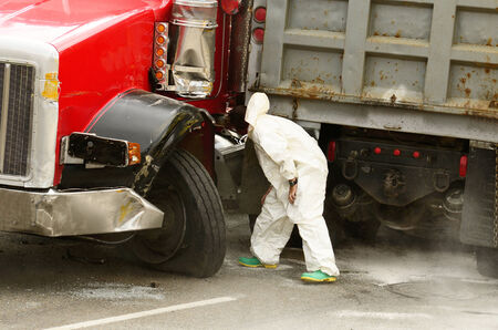 Hazardous materials cleanup company working at a  four vehicle accident involving two large trucks resulted in a single injury and a diesel fuel spill. July 20, 2012 in Roseburg Oregon