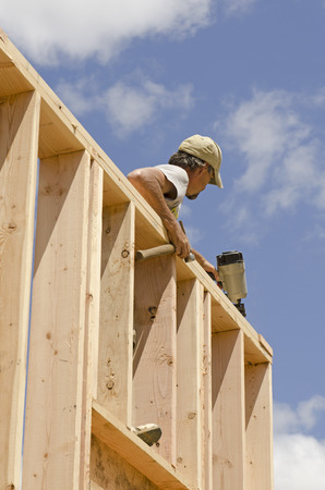 stud: Framing Contractor building in a window or door opening in outside bearing wood stud wall Editorial