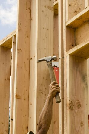 stud: Framing Contractor building in a window or door opening in outside bearing wood stud wall Stock Photo