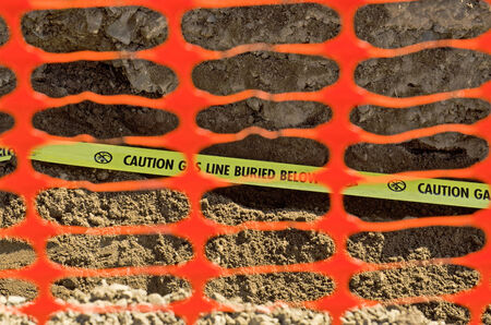 pipework: Natural Gas lines in a utilities trench at a commercial development building site Stock Photo