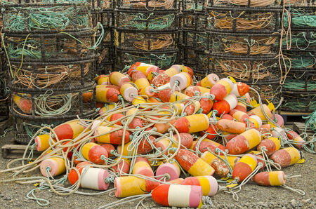 crab pot: A group of crab rings, rope and other gear waits on a dock for next season in Oregon Stock Photo