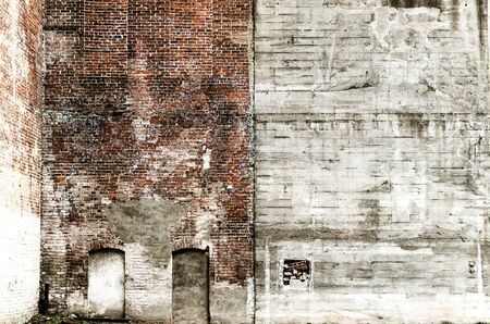 masonary: Detail of an old clay brick masonary wall and mortar showing settling, and aging on a downtown commercial building Stock Photo