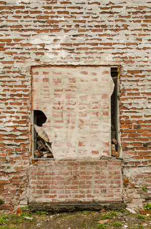 settling: Detail of an old clay brick masonary wall and mortar showing settling, and aging on a downtown commercial building Stock Photo
