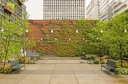 eating area: Great small park and eating area with ivy and brick in a downtown area of  Portland Oregon