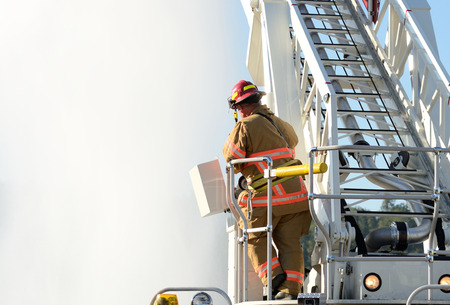 appliance: Firefighters on using large volume appliance water delivery to a ladder truck