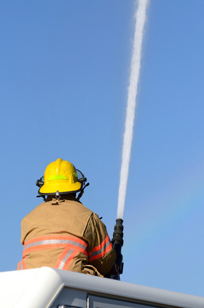 master volume: Firefighters on using large volume appliance water delivery master streams Stock Photo