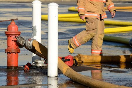 master volume: Firefighters at the fire hydrant while using large volume appliance water delivery master streams