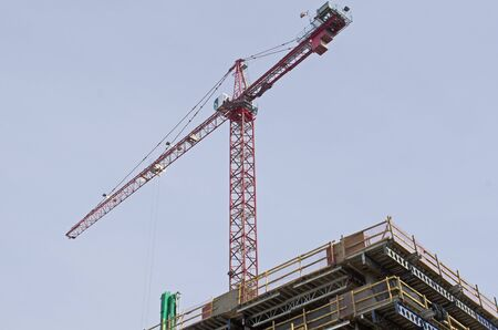 Large tower crane at a modern urban, development constuction site  in an concrete and metal project Reklamní fotografie