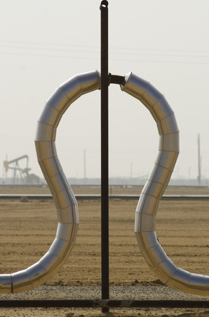 Lyre or horseshoe expansion loop on a pipeline in a central California oil field Фото со стока