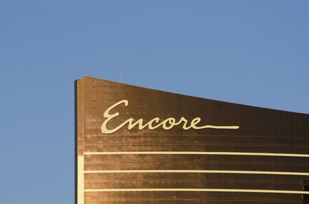Las Vegas  November 11 2014: The sun reflects off the golden windows of the Encore part of the Wynn Hotel and Casino on the Las Vegas Strip