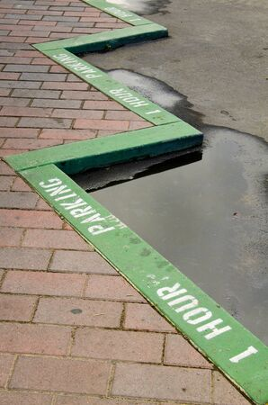 curb: One hour parking green curb on a downtown city are of a southern California city