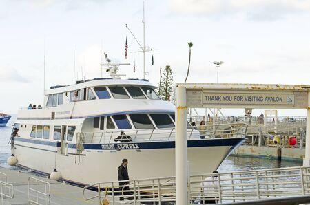 catalina: Catalina Express passenger ferry boat arrives in harbor at the port of Avalon on Catalina Island, California Editorial