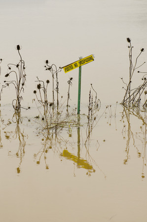 trespassing: A no trespassing sign sits in a flooded agricultural field in Oregon following a heavy rain Stock Photo