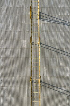 agricultural area: ladder hanggin in Large commercial grain silo sites in agricultural area of Oregon with a ladder and shadow