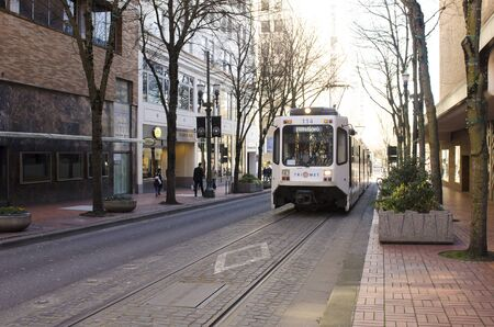 south park: Portland, OR, USA - February 21, 2014: Mass transit train operates in downtown Portland, South Park Blocks Editorial