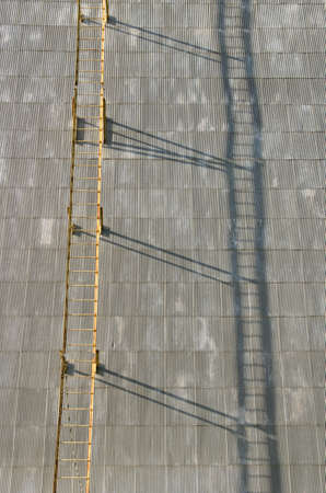 agricultural area: Large commercial grain silo sits in agricultural area of Oregon with a ladder and shadow Stock Photo