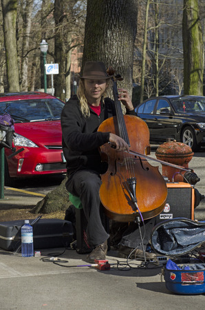 Portland, OR, USA - February 21, 2014: Street muscian playing in the Parks Blocks secion of Portland Oregon