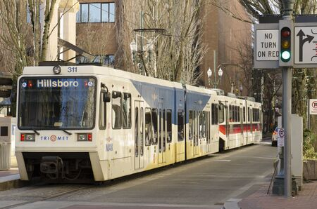 operates: Portland, OR, USA - February 21, 2014: Mass transit train operates in downtown Portland, Editorial