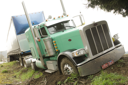 semitruck: Winston, OR, USA - February 27, 2012: Large semi truck drives off the road and nearly rolls over following a driver medical problem