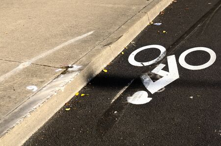 Obvious vehicle brake marks on a bike lane marker symbol at an vehicle accident scene