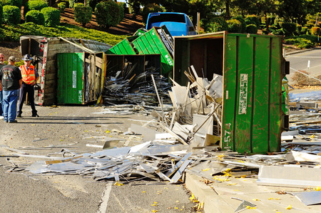 patrolman: ROSEBURG, OR - OCTOBER 16:A truck loaded with scrap aluminum rolls on its side at the entrance to Interstate 5 causes backup in Roseburg Oregon, October 16, 2012