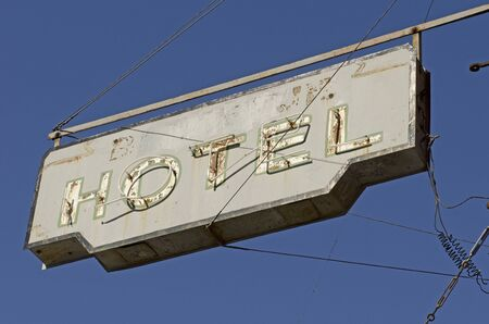 hotel sign: Vintage neon hotel sign against a blue sky Stock Photo
