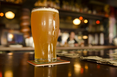 cold beer: Concept of the cost of craft beers at a Oregon microbrew pub Stock Photo