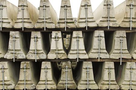 Stack of freeway or construciton divider traffic barricades Standard-Bild