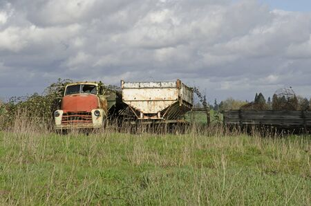 An old truck and trailer sits abandoned on a Oregon farm
