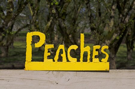 Sign on a fence outside a Peach orchard in Oregon