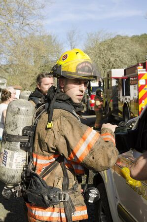 Roseburg OR, USA - March 26, 2014: Fire incident commander fire chief discussing operations with firefighters on a structure fire of a mobile home Editorial