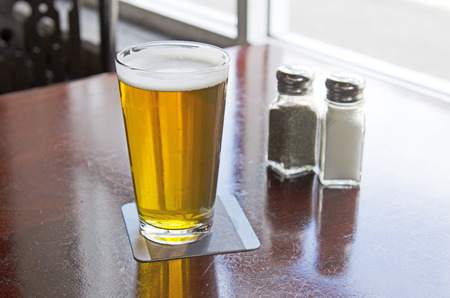 Salt and pepper shakers on a table at a restaurant,