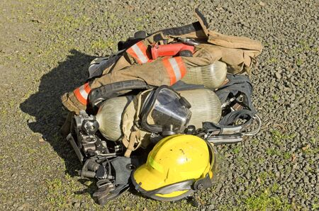 Roseburg OR, USA - March 26, 2014: Firefighter air tank and SCBA on a structure fire of a mobile home