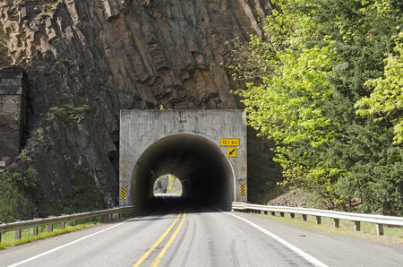 Tunnel 1 through a columnar basalt along Washington State Hwy 14 in the Columbia River Gorge Stock Photo