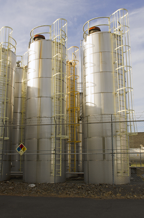 Large stainless steel tanks full of alcohol at a micro distillery in Oregon