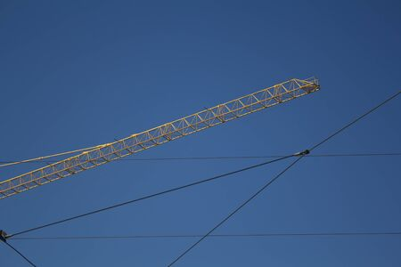 energy work: Crane and Electrical wires on a blue sky