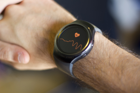Arm of man with smartwatch on wrist measuring heart beat Stok Fotoğraf